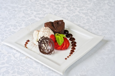 Chocolate flan with strawberries and chocolate, a wonderful dessert photo