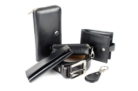 Leather male bag with accessories on a white