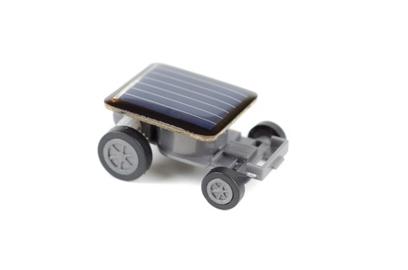 Solar powered toy car on a white background. for concept. photo