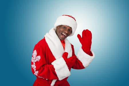 surprised black santa claus on a blue background photo