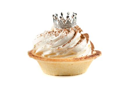 cupcake and bijouterie jewelry crown on a white background photo