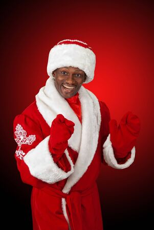 surprised black santa claus on a red background photo