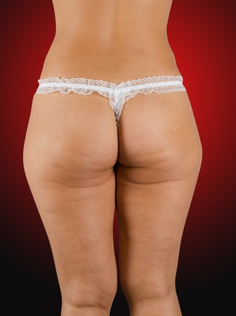 Closeup of adult woman buttocks on a red Stock Photo
