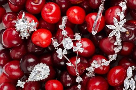 Jewels at fruit red ripe cherries berry background photo