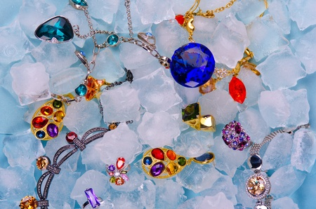 Jewels at blue cube of ice background Stock Photo - 11765000