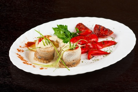 fillet of pikeperch stuffed with trout fish with baked pepper, tomato and leek photo