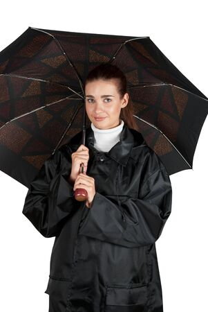 woman in rain coat with umbrella on a white photo