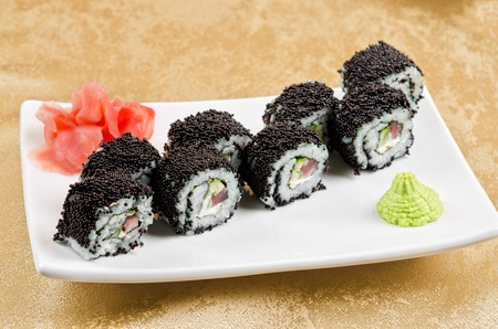 sushi roll with tuna, avacado, sauce and flying fish roe photo