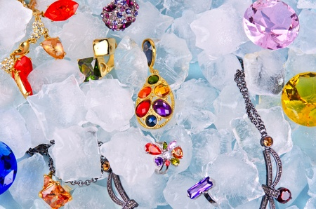 Jewels at blue cube of ice background photo