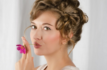 beauty woman closeup portrait with flower over grey background Stock Photo - 12326376