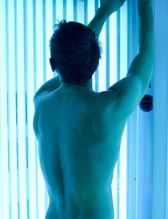 young man closeup at tanning solarium light on Stock Photo - 12326405