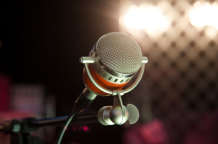 Closeup of audio microphone on stage background Standard-Bild