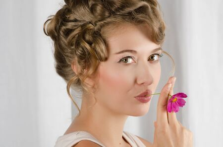 beauty woman closeup portrait with flower over grey background Stock Photo - 12326419