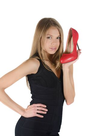 beautiful young woman with a red shoe on white photo