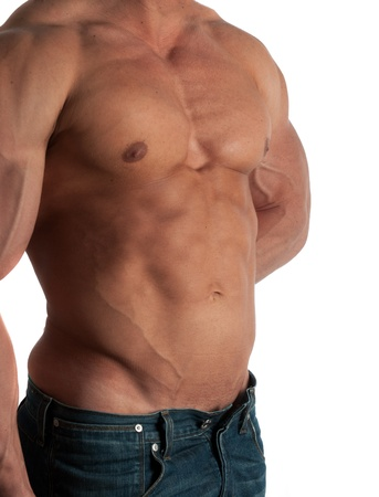 Muscular male torso of bodybuilder at jeans on white background photo