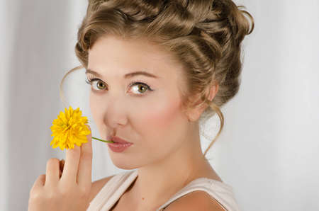 beauty woman closeup portrait with flower over grey background Stock Photo - 12600859
