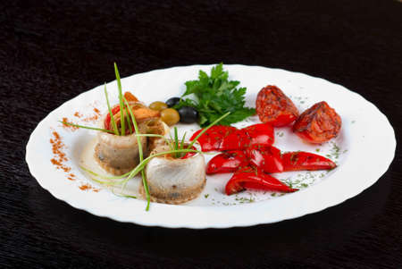fillet of pikeperch stuffed with trout fish with baked pepper, tomato and leek Stock Photo - 12668796