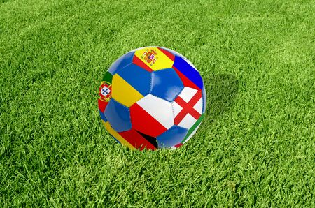 Soccer ball on grass field background  Ball filled with euro 2012 countries flags colors  Stock Photo - 12888223