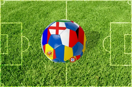 Soccer ball on grass field background  Ball filled with euro 2012 countries flags colors Stock Photo - 12888224