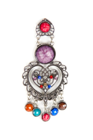 brooch with different gems isolated on a white photo