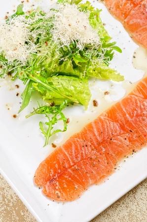 Fish Carpaccio with salad and mozzarella Stock Photo - 12888576