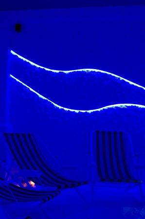 Relaxation speleoclimatic salt room on dark blue illumination photo