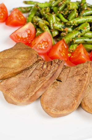 grilled beef tongue with green beans and tomato cherry photo