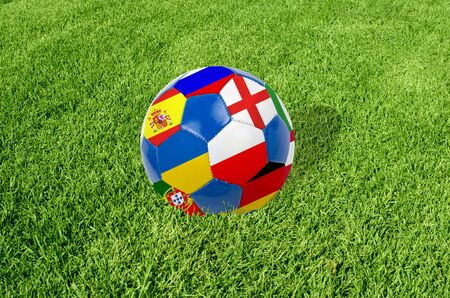 Soccer ball on grass field background  Ball filled with euro 2012 countries flags colors Stock Photo - 13296639