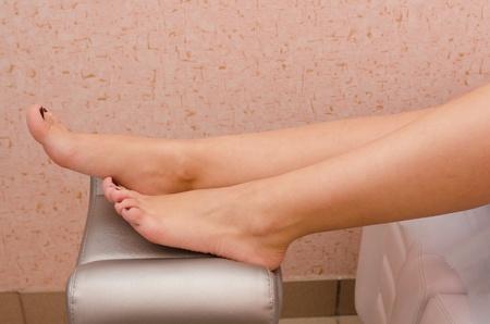 french manicure sexy woman: body part shot of beautiful woman s legs Stock Photo