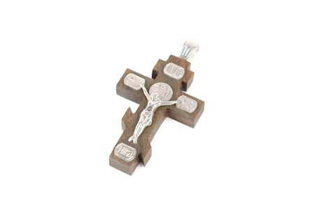 silver and wooden cross with religious inscriptions isolated on a white photo