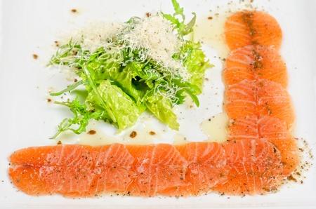Fish Carpaccio with salad and mozzarella Stock Photo - 13336331