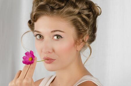 beauty woman closeup portrait with flower over grey background Stock Photo - 13434185