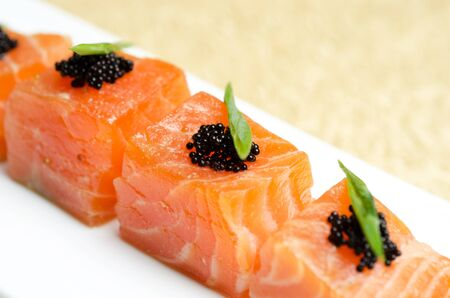 Salmon Slices with black tobiko caviar and greens Stock Photo - 13622579