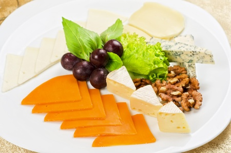 cheese with lettuce, grapes and nuts closeup Stock Photo - 13681456