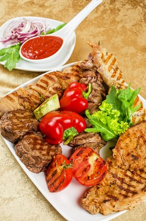 BBQ meat with vegetables and greens closeup Stock Photo - 13722907