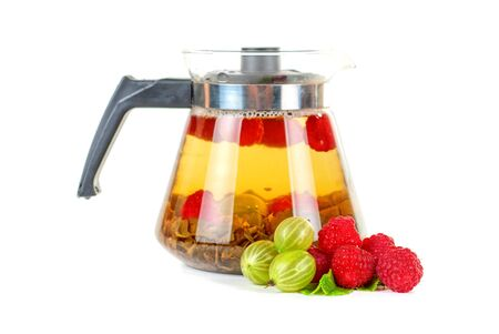 Teapot with fruit tea and berries on a white background Stock Photo - 13753342
