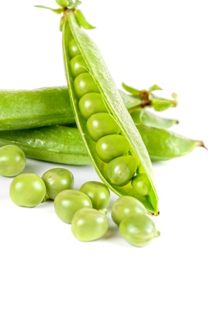 Ripe pea vegetable with green leaf isolated on white background Stock Photo - 13872281