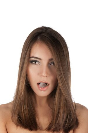 Beautiful girl hold ice cube in mouth and eat it Stock Photo - 14168625