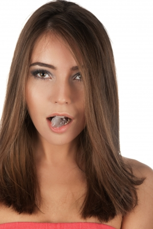 Beautiful girl hold ice cube in mouth and eat it Stock Photo - 14225654