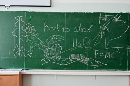 Green chalk blackboard written Back To School with white chalk photo
