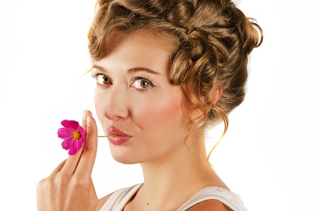 beauty woman closeup portrait with flower over grey background Stock Photo - 14471522