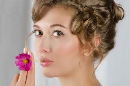 beauty woman closeup portrait with flower over grey background Stock Photo - 14551594