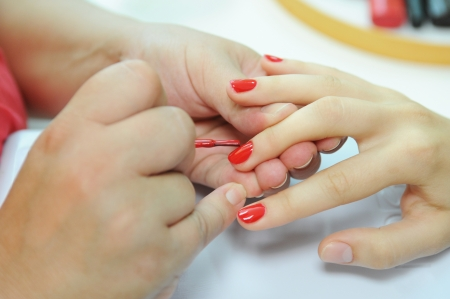 Manicure nail paint red color photo