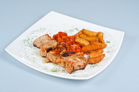 Grilled kebab pork meat with roasted potato and vegetables Stock Photo - 14711283