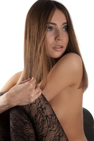 Young beautiful woman sitting on a white Stock Photo - 14711341