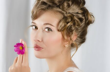 beauty woman closeup portrait with flower over grey background Stock Photo - 14711372