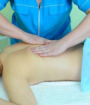 Closeup photo of massage of female back photo