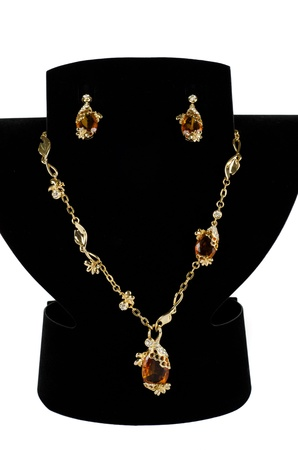 a necklace with pendants and earrings on a white background photo
