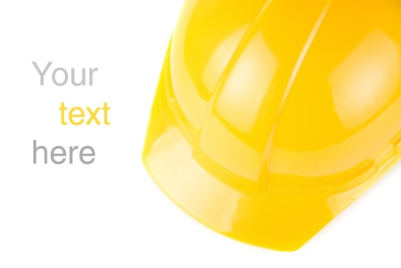 Yellow build helmet closeup with space to text