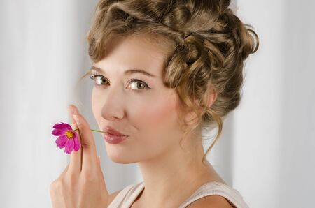beauty woman closeup portrait with flower over grey background Stock Photo - 15473319